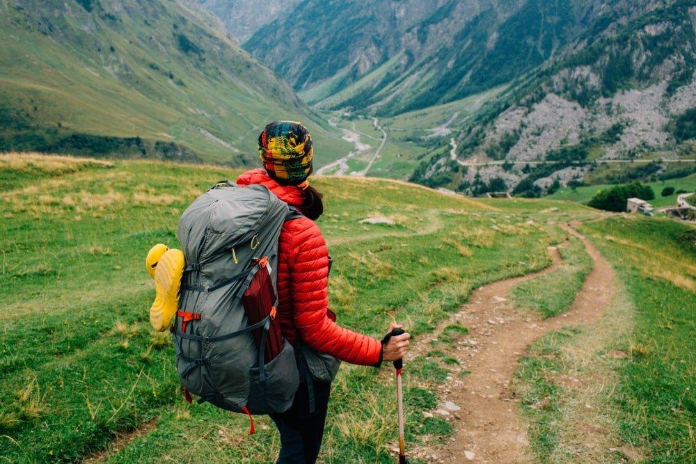 Female hiker looking around